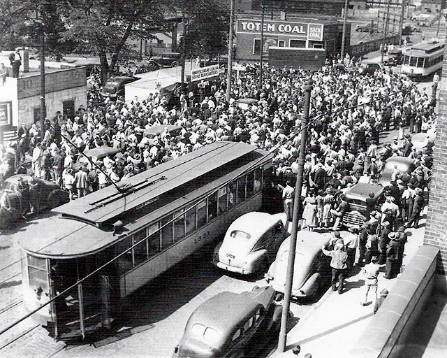 Protesting Minneapolis Moline's layoff policies, disgruntled workers launched a strike and temporarily blocked traffic on Lake Street as a sign of protest.