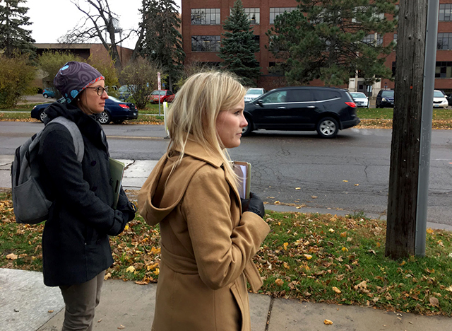 Dr. Nichole Morris training volunteers to study crosswalk law compliance in St. Paul, fall of 2018.