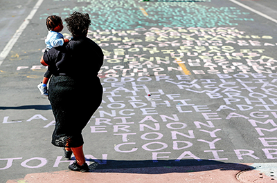 a street painted with the names of people killed by police