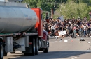 A tanker truck drives into thousands of protesters