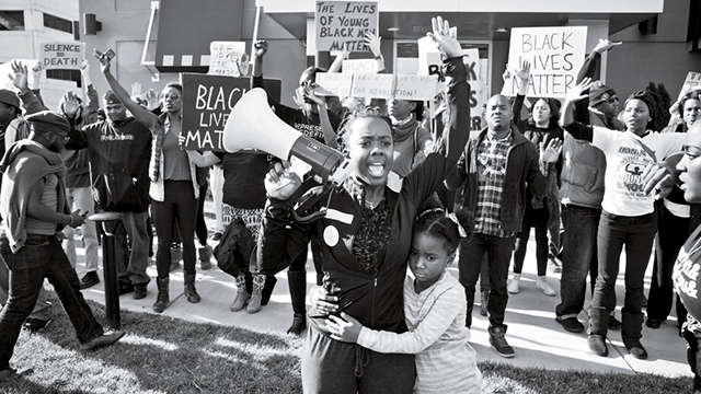 "A scene from the 2014 documentary ""Whose Streets?"""