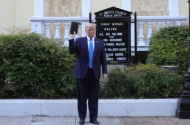 photo of president trump holding a bible aloft