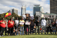 People gather during a demonstration in solidarity with the Black Lives Matter