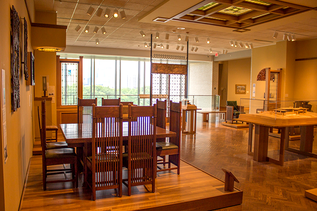 Foreground: Frank Lloyd Wright Chair, from a dining set, on view in Gallery 300.