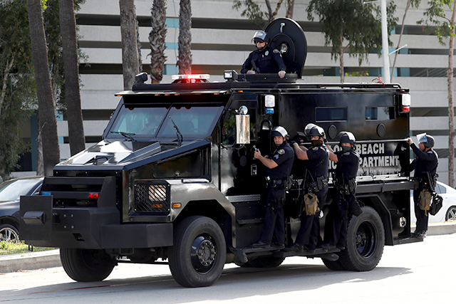 Police in riot gear on an armored vehicle in Long Beach, California, on May 31.