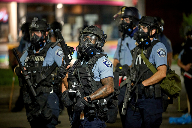 Minneapolis police officers shown gathered around the Third Precinct during a protest on May 27.