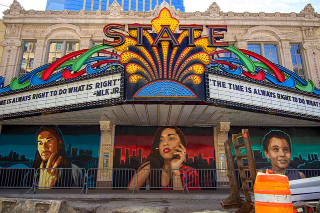 """Visual artist and muralist Reggie LeFlore spent two weeks painting """"The Overseer, Divinity and Humanity"""" beneath the State's wide marquee."""