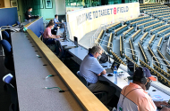 Sportswriters practicing social distancing while covering a Twins workout from the Target Field press box.