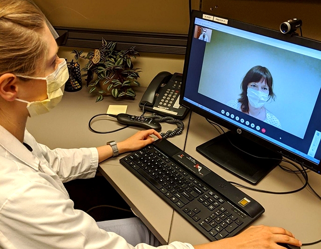 A counselor speaking to a patient via a M Health Fairview telehealth hub.