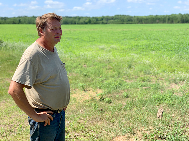 Tim Nolte, a farmer from Wadena County, examines the land he wants to irrigate.
