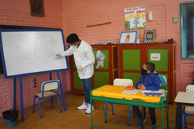 Teacher Sergio Ferrao giving a lesson about the coronavirus to his students at a rural school in San Jose, Uruguay.
