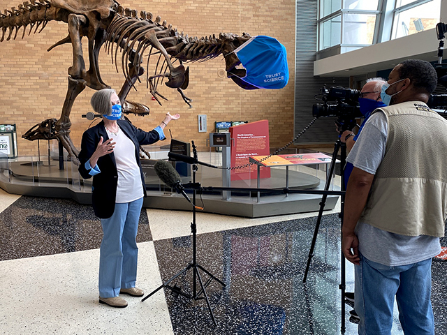 Science Museum CEO Alison Rempel Brown speaking with local news photographers during last Friday's preliminary walk-through.
