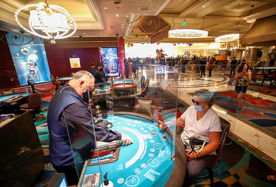 A blackjack player gives a thumbs up to dealer Dave Mitchell during the reopening of the Bellagio Hotel and Casino, on June 4.