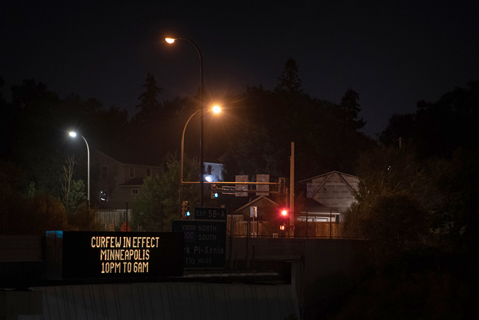 A digital sign on Interstate 394 announcing the curfew for Minneapolis.
