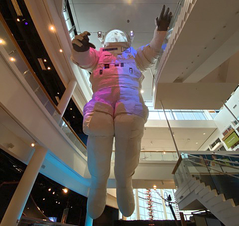 The museum has a big, wide, airy staircase, right below the giant astronaut.