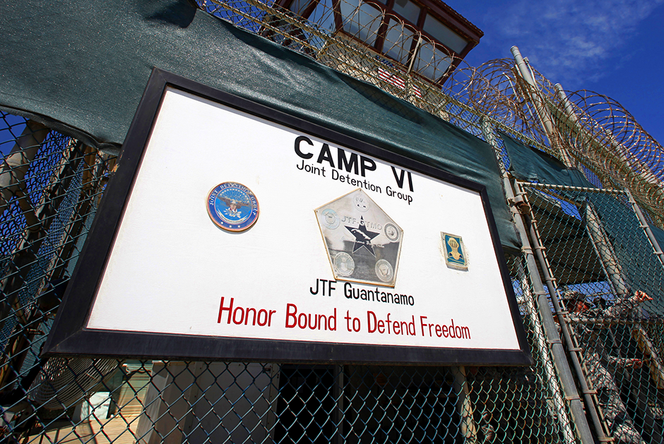 A guard opens the gate at the entrance to Camp VI, a prison used to house detainees at the U.S. Naval Base at Guantanamo Bay, Cuba.
