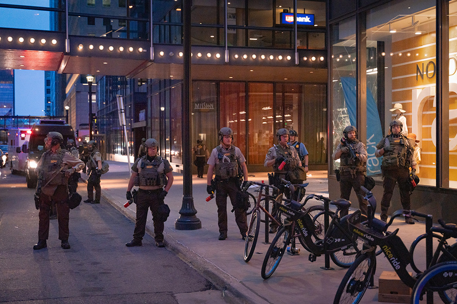 Hennepin County Sheriffs officers patrolling outside the Norstrom Rack in the IDS Center in Minneapolis following the looting and vandalism of Wednesday evening.