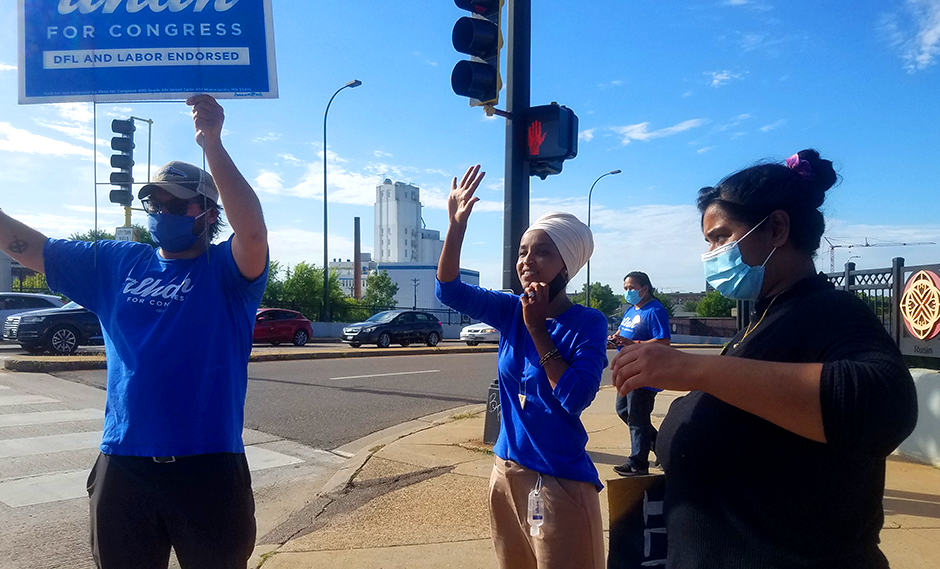 CD5 Rep. Ilhan Omar and supporters campaigning on Tuesday at Central and Broadway in Minneapolis.