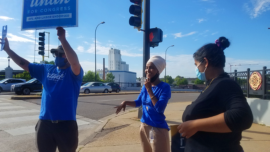 CD5 Rep. Ilhan Omar and supporters rallying potential voters on Tuesday at Central and Broadway in Minneapolis.