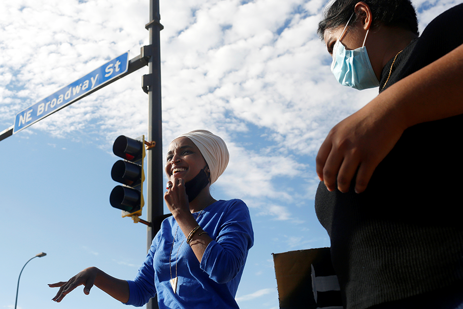 """Rep. Ilhan Omar with volunteers and campaign members in northeast Minneapolis for a """"Get Out The Vote"""" event on August 11."""