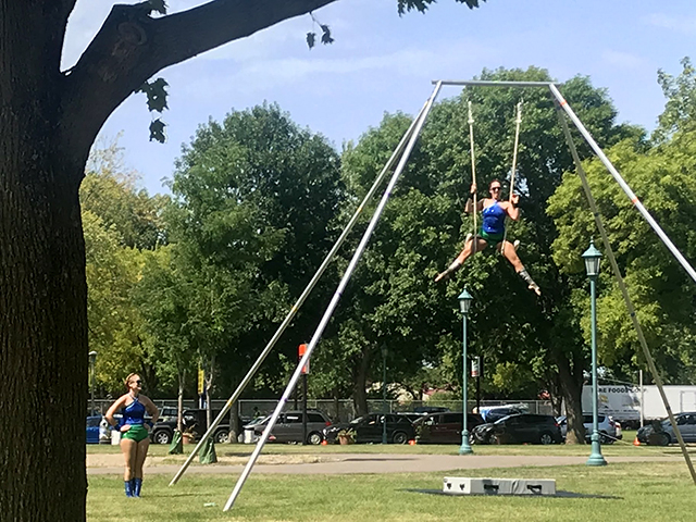 Twin Cities Trapeze Center is one of the live entertainment acts on the food parade route.