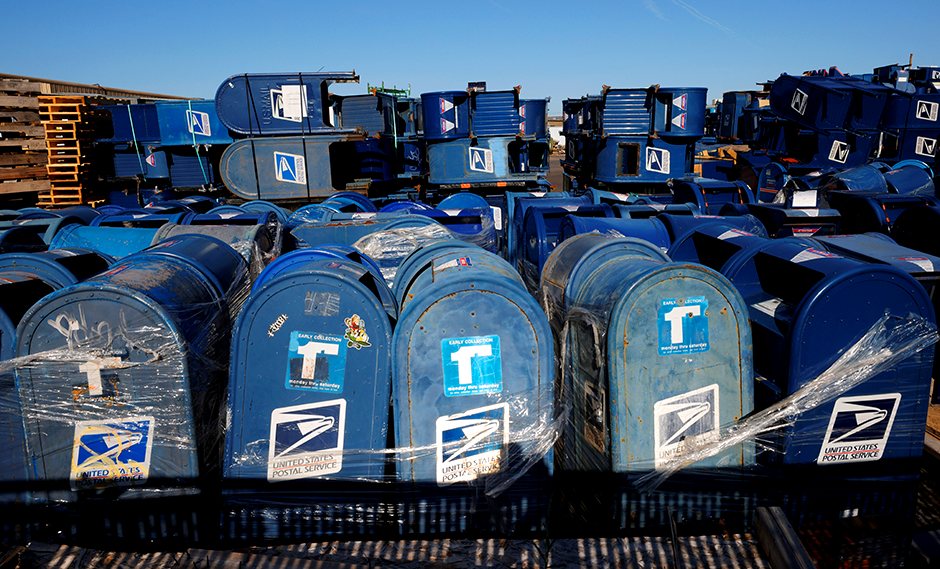 United States Postal Service mailboxes stacked in an industrial lot in Hartford, Wisconsin, on Sunday.