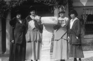 historic photo of four women holding a petition