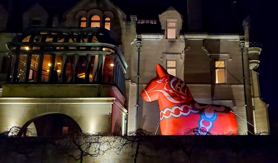 A night shot of ASI's Dala Horse outside the Turnblad Mansion.