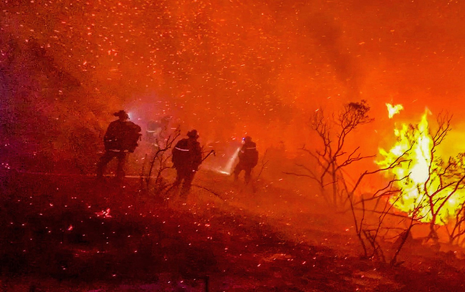 Firefighters work to extinguish a fire in Alpine, California, on September 6, 2020.