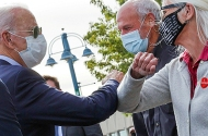 Former Vice President Joe Biden gets elbow bump greetings from local supporters