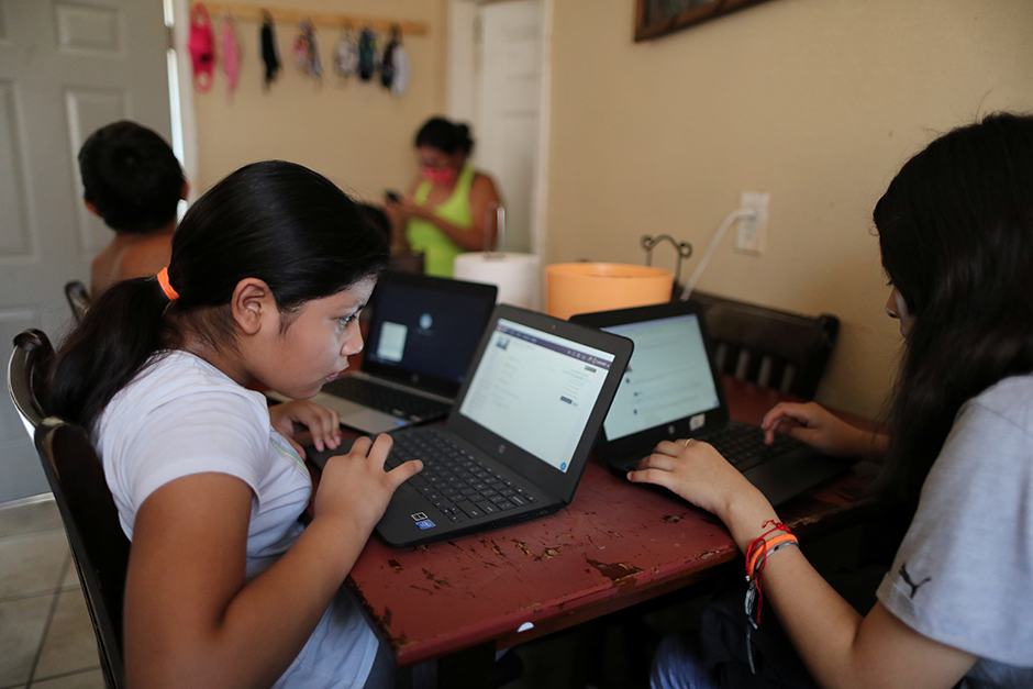 Students doing schoolwork from home during the global coronavirus outbreak.