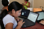 Students doing schoolwork from home during the global coronavirus outbreak