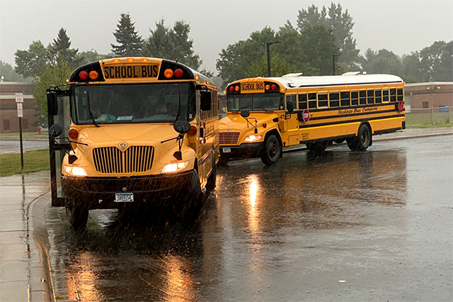 Hastings school buses dropping off students on Monday.