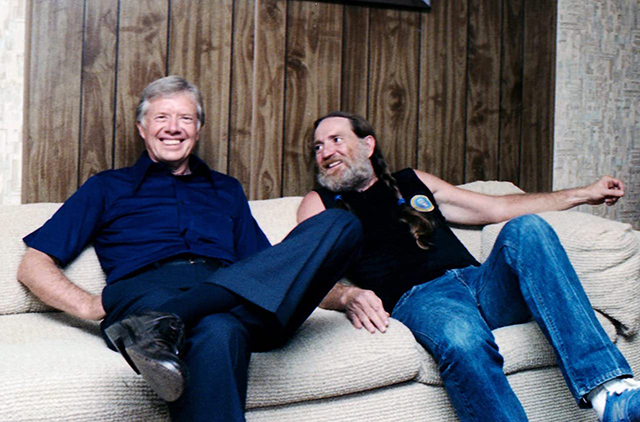"A still from ""Jimmy Carter"" featuring Carter and country singer Willie Nelson."