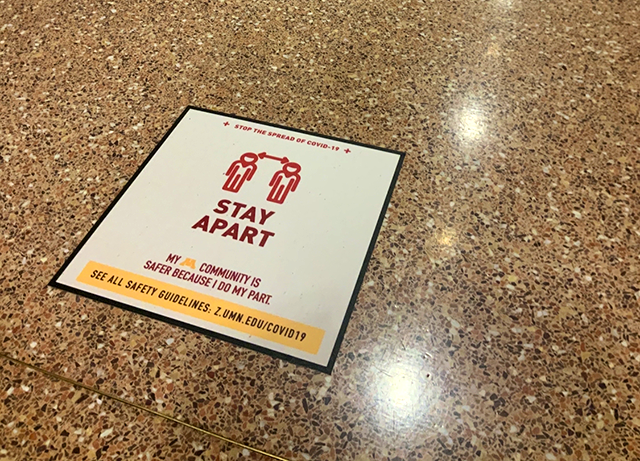 Social-distance signage on the floor of the Northrop lobby.
