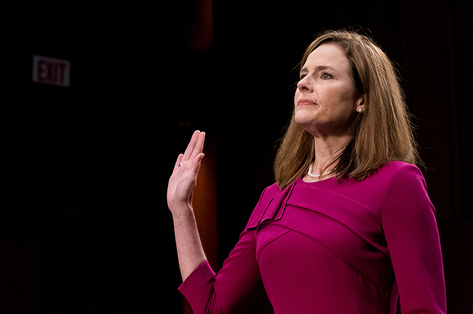 Supreme Court nominee Amy Coney Barrett is sworn in during the first day of her confirmation hearing before the Senate Judiciary Committee.