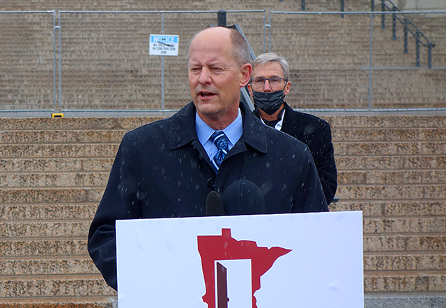 "Senate Majority Leader Paul Gazelka speaking at an ""Open Up MN"" press conference on Monday. Behind him is state Sen. Scott Jensen."