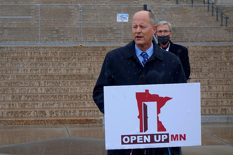 "Senate Majority Leader Paul Gazelka speaking at an ""Open Up MN"" press conference on Monday. Behind him is state Sen. Scott Jensen."