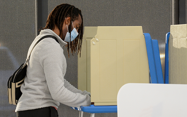 A voter marks his ballot during early voting in Minneapolis on September 18.