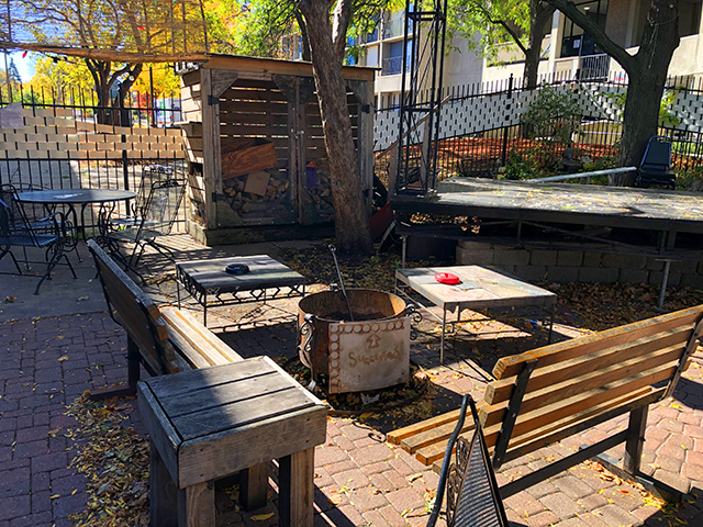 Palmer's has a large patio with a fire pit that sprawls out beneath the concrete abutment of the next-door housing complex.