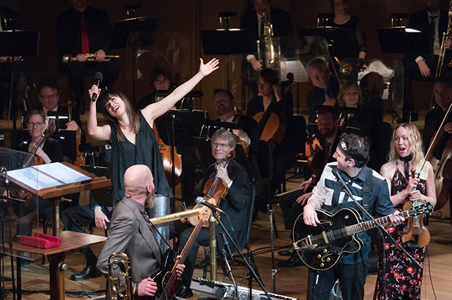 Sarah Hicks leading the Minnesota Orchestra, with indie rock band Cloud Cult, in 2018.