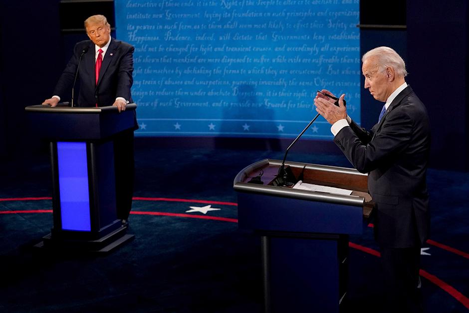 Former Vice President Joe Biden answers a question as President Donald Trump listens