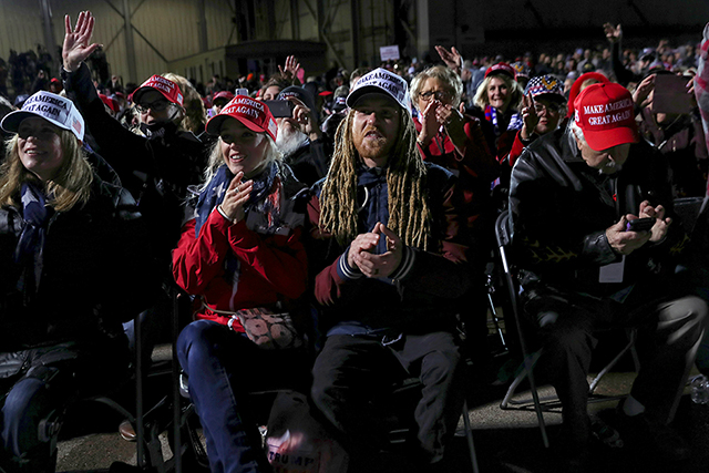 Supporters of President Donald Trump react during a campaign rally at Duluth International Airport on Wednesday.
