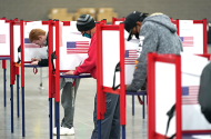 Voters filling out ballots at the Kentucky Exposition Center