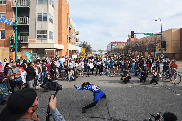 A man dancing during a celebration at East Lake St. and 21st Avenue S. in Minneapolis on Saturday afternoon.