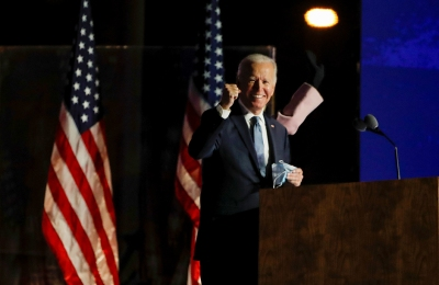 Former Vice President Joe Biden raises a fist as he delivers remarks on Election Night in Wilmington, Delaware.