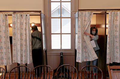 Voters casting their ballots at Florence Town Hall on Election Day in Frontenac, Minnesota.