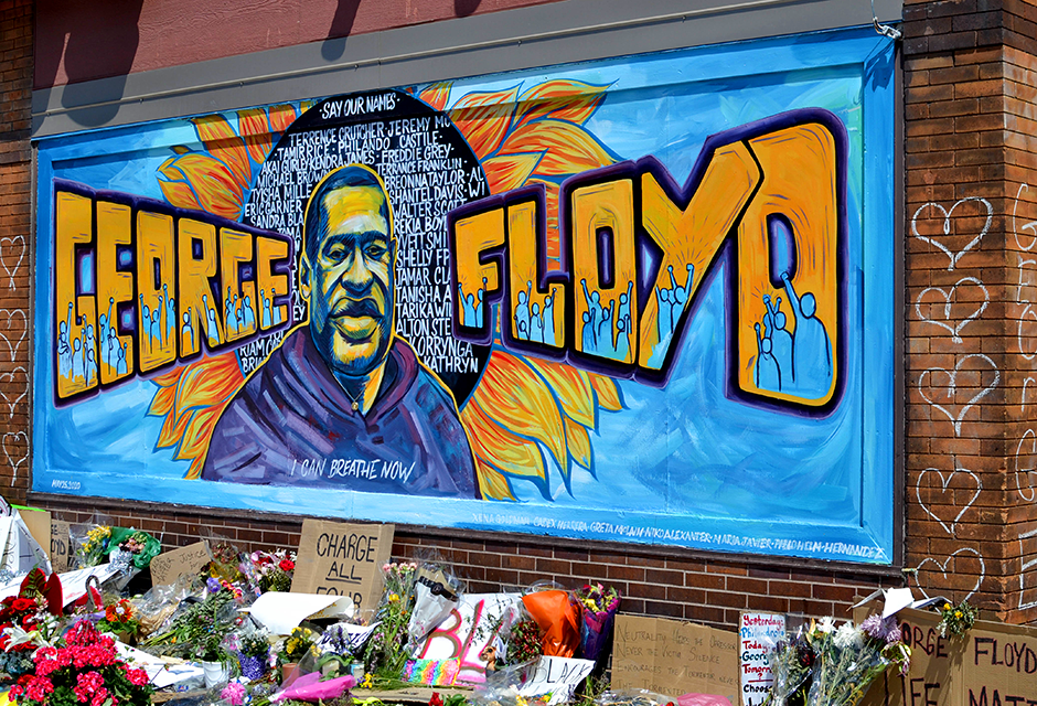 A mural honoring George Floyd on display outside of Cup Foods in Minneapolis near where he died.
