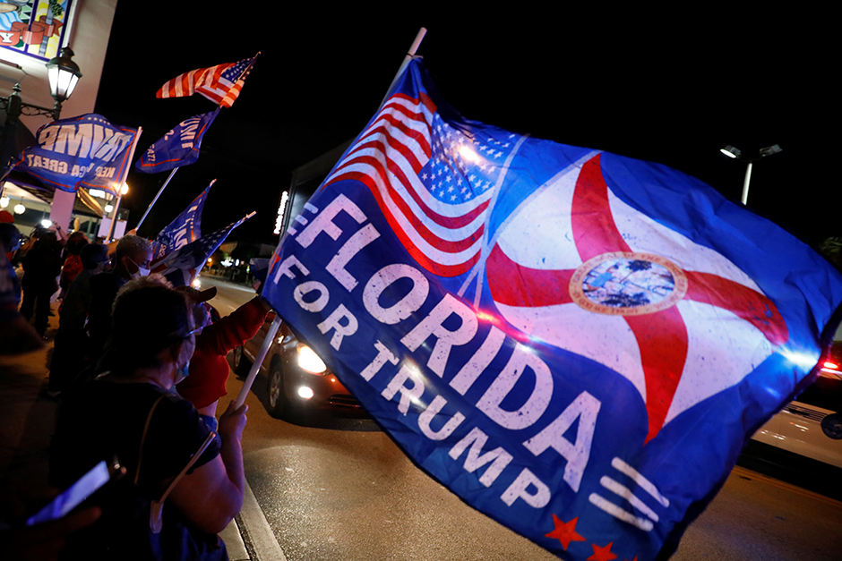 Supporters of President Donald Trump waving flags in the Little Havana neighborhood of Miami, Florida, on November 3.