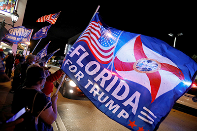 Supporters of President Donald Trump waving flags